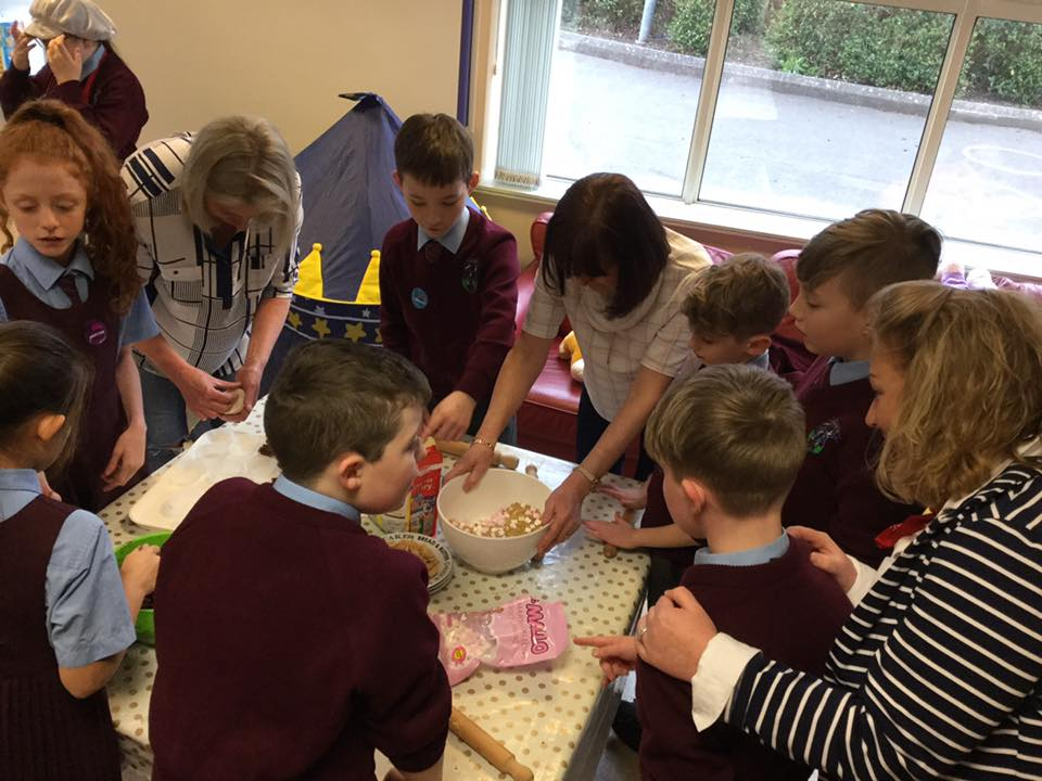 Fairtrade Committee baking buns with mums and Mrs McGranaghan