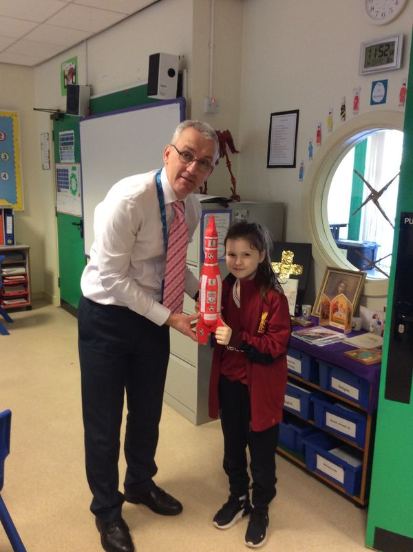 "Ava presenting Mr. Carlin with a Liverpool Rocket ""because Liverpool are flying at the minute""."